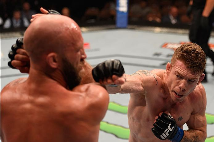 LAS VEGAS, NV - MAY 29: (R-L) Paul Felder punches Joshua Burkman in their lightweight bout during the UFC Fight Night event inside the Mandalay Bay Events Center on May 29, 2016 in Las Vegas, Nevada.  (Photo by Josh Hedges/Zuffa LLC/Zuffa LLC via Getty Images) *** Local Caption *** Joshua Burkman; Paul Felder