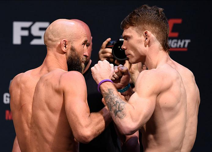 LAS VEGAS, NV - MAY 28:   (L-R) Opponents Joshua Burkman and Paul Felder face off during the UFC Fight Night weigh-in at the Mandalay Bay Events Center on May 28, 2016 in Las Vegas, Nevada. (Photo by Josh Hedges/Zuffa LLC/Zuffa LLC via Getty Images)