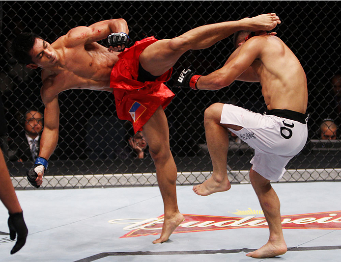 MACAU - MARCH 01: Mark Eddiva throws a kick on Jumabieke Tuerxun in their featherweight fight during the UFC Fight Night event at the Venetian Macau on March 1, 2014 in Macau. (Photo by Mitch Viquez/Zuffa LLC/Zuffa LLC via Getty Images)
