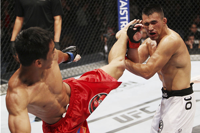 MACAU - MARCH 01:  Mark Eddiva lands a kick on Jumabieke Tuerxun in their featherweight fight during the UFC Fight Night event at the Venetian Macau on March 1, 2014 in Macau. (Photo by Mitch Viquez/Zuffa LLC/Zuffa LLC via Getty Images)