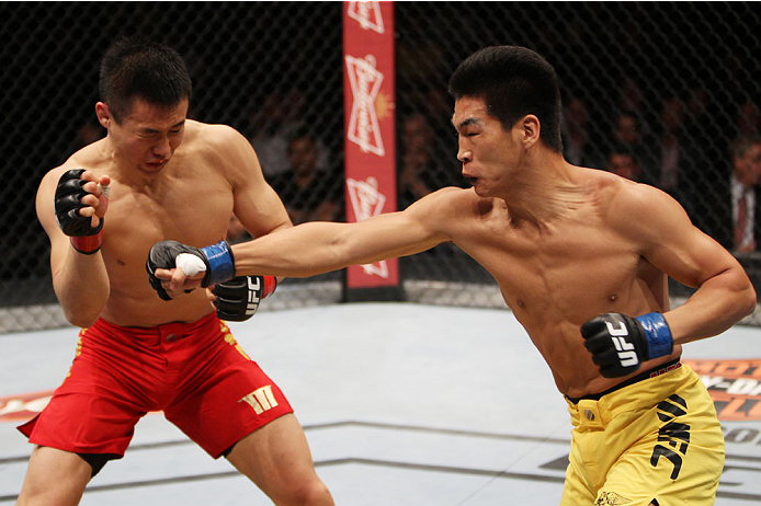 MACAU - MARCH 01:  Wang Anying throws a punch on Albert Cheng in their welterweight fight during the UFC Fight Night event at the Venetian Macau on March 1, 2014 in Macau. (Photo by Mitch Viquez/Zuffa LLC/Zuffa LLC via Getty Images)