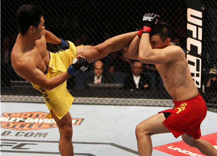 MACAU - MARCH 01:  Wang Anying attempts a kick on Albert Cheng in their welterweight fight during the UFC Fight Night event at the Venetian Macau on March 1, 2014 in Macau. (Photo by Mitch Viquez/Zuffa LLC/Zuffa LLC via Getty Images)