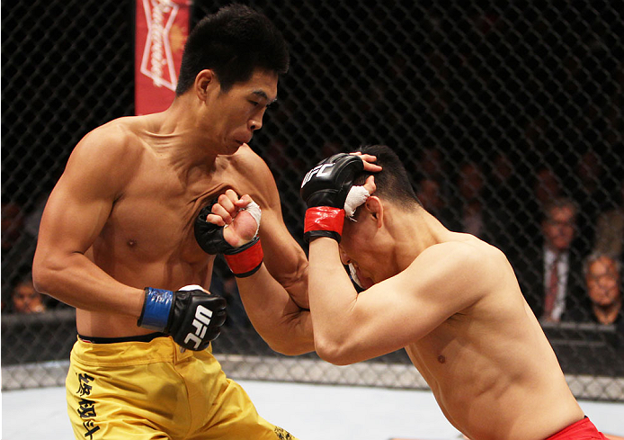 MACAU - MARCH 01:  (L to R) Wang Anying and Albert Cheng exchange punches in their welterweight fight during the UFC Fight Night event at the Venetian Macau on March 1, 2014 in Macau. (Photo by Mitch Viquez/Zuffa LLC/Zuffa LLC via Getty Images)