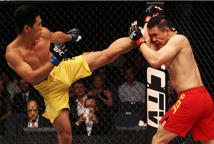 MACAU - MARCH 01:  Wang Anying throws a kick on Albert Cheng in their welterweight fight during the UFC Fight Night event at the Venetian Macau on March 1, 2014 in Macau. (Photo by Mitch Viquez/Zuffa LLC/Zuffa LLC via Getty Images)