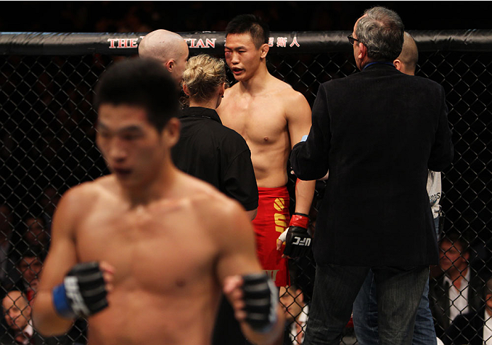 MACAU - MARCH 01:  Albert Cheng is looked over by the doctors while Wang Anying poses for a photo after his win in their welterweight fight during the UFC Fight Night event at the Venetian Macau on March 1, 2014 in Macau. (Photo by Mitch Viquez/Zuffa LLC/Zuffa LLC via Getty Images)