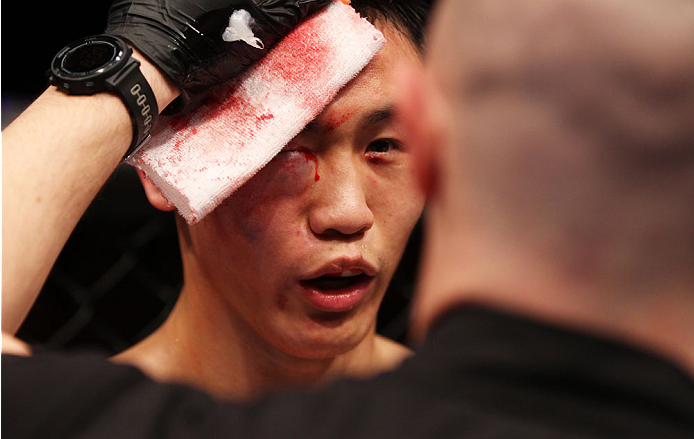 MACAU - MARCH 01:  Albert Cheng is examined by the doctors after he could no longer continue in his bout with Wang Anying in their welterweight fight during the UFC Fight Night event at the Venetian Macau on March 1, 2014 in Macau. (Photo by Mitch Viquez/Zuffa LLC/Zuffa LLC via Getty Images)
