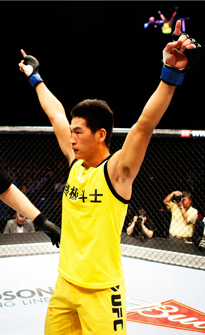 MACAU - MARCH 01: Wang Anying celebrates his win over Albert Cheng in their welterweight fight during the UFC Fight Night event at the Venetian Macau on March 1, 2014 in Macau. (Photo by Mitch Viquez/Zuffa LLC/Zuffa LLC via Getty Images)