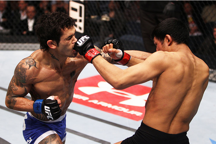 MACAU - MARCH 01:  Vaughan Lee receives a punch from Nam Phan in their bantamweight fight during the UFC Fight Night event at the Venetian Macau on March 1, 2014 in Macau. (Photo by Mitch Viquez/Zuffa LLC/Zuffa LLC via Getty Images)