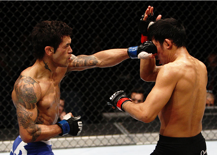 MACAU - MARCH 01:  Vaughan Lee lands a punch on Nam Phan in their bantamweight fight during the UFC Fight Night event at the Venetian Macau on March 1, 2014 in Macau. (Photo by Mitch Viquez/Zuffa LLC/Zuffa LLC via Getty Images)