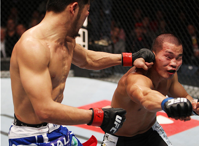 MACAU - MARCH 01:  Yui Chul Nam lands a punch on Kazuki Tokudome in their lightweight fight during the UFC Fight Night event at the Venetian Macau on March 1, 2014 in Macau. (Photo by Mitch Viquez/Zuffa LL/C/Zuffa LLC via Getty Images)