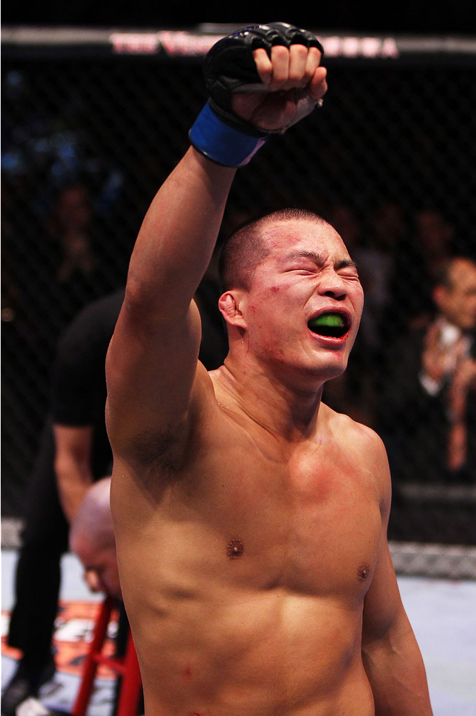 MACAU - MARCH 01:  Kazuki Tokudome celebrates his victory over Yui Chul Nam in their lightweight fight during the UFC Fight Night event at the Venetian Macau on March 1, 2014 in Macau. (Photo by Mitch Viquez/Zuffa LLC/Zuffa LLC via Getty Images)