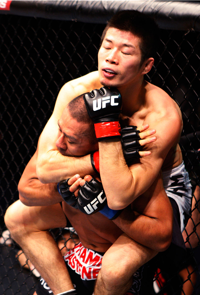 MACAU - MARCH 01:  Hatsu Hioki goes for a submission attempt on Ivan Menjivar in their featherweight fight during the UFC Fight Night event at the Venetian Macau on March 1, 2014 in Macau. (Photo by Mitch Viquez/Zuffa LLC/Zuffa LLC via Getty Images)