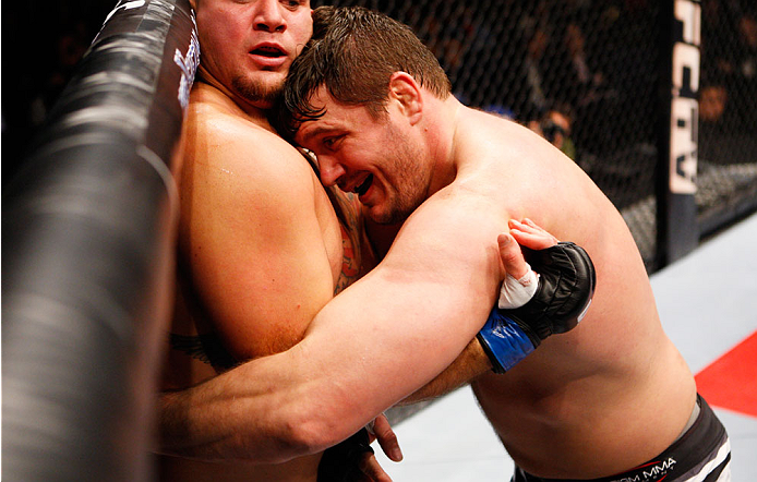 MACAU - MARCH 01: Matt Mitrione pushes Shawn Jordan against the cage in their heavyweight fight during the UFC Fight Night event at the Venetian Macau on March 1, 2014 in Macau. (Photo by Mitch Viquez/Zuffa LLC/Zuffa LLC via Getty Images)