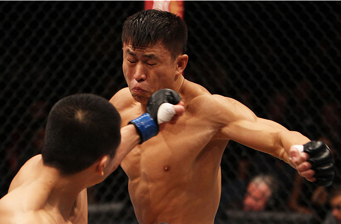 MACAU - MARCH 01:  Wang Sai is hit by a punch from Lipeng Zhang in their TUF China welterweight finals fight during the UFC Fight Night event at the Venetian Macau on March 1, 2014 in Macau. (Photo by Mitch Viquez/Zuffa LLC/Zuffa LLC via Getty Images)