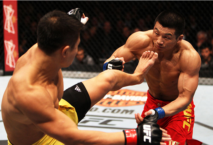 MACAU - MARCH 01:  Wang Sai throws a kick at Lipeng Zhang in their TUF China welterweight finals fight during the UFC Fight Night event at the Venetian Macau on March 1, 2014 in Macau. (Photo by Mitch Viquez/Zuffa LLC/Zuffa LLC via Getty Images)