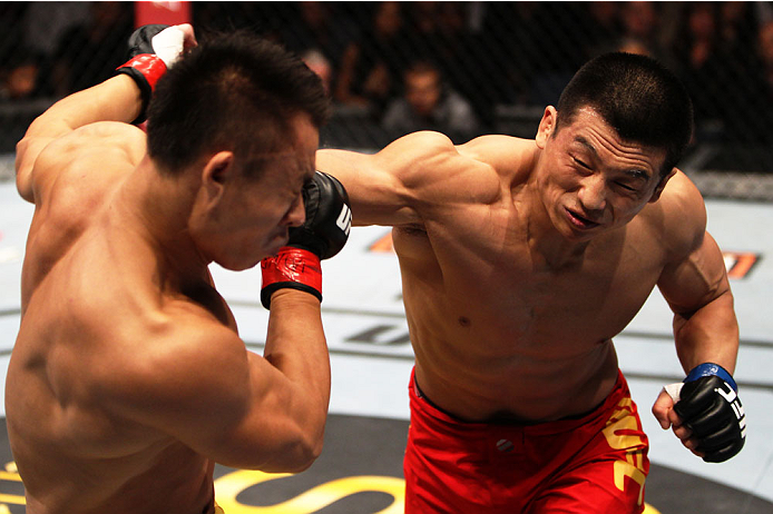 MACAU - MARCH 01:  Lipeng Zhang lands a punch on Wang Sai in their TUF China welterweight finals fight during the UFC Fight Night event at the Venetian Macau on March 1, 2014 in Macau. (Photo by Mitch Viquez/Zuffa LLC/Zuffa LLC via Getty Images)
