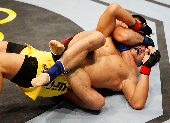 MACAU - MARCH 01:  Zhang Lipeng goes for a choke on Wang Sai in their TUF China welterweight finals fight during the UFC Fight Night event at the Venetian Macau on March 1, 2014 in Macau. (Photo by Mitch Viquez/Zuffa LLC/Zuffa LLC via Getty Images)