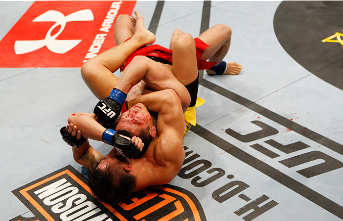 MACAU - MARCH 01:  Wang Sai goes for a choke on Zhang Lipeng in their TUF China welterweight finals fight during the UFC Fight Night event at the Venetian Macau on March 1, 2014 in Macau. (Photo by Mitch Viquez/Zuffa LLC/Zuffa LLC via Getty Images)