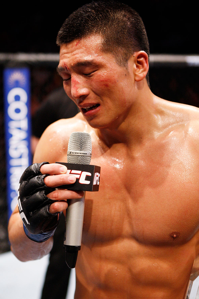 MACAU - MARCH 01:  Zhang Lipeng is emotional after his win over Wang Sai in their TUF China welterweight finals fight during the UFC Fight Night event at the Venetian Macau on March 1, 2014 in Macau. (Photo by Mitch Viquez/Zuffa LLC/Zuffa LLC via Getty Images)