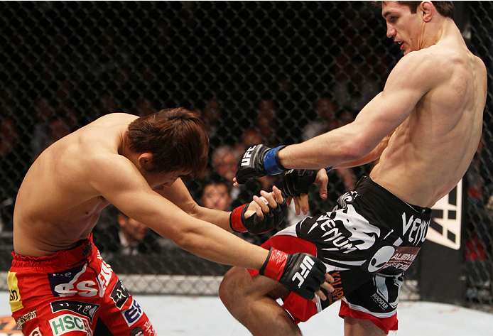 MACAU - MARCH 01:  John Hathaway throws a knee at Dong Hyun Kim in their welterweight fight during the UFC Fight Night event at the Venetian Macau on March 1, 2014 in Macau. (Photo by Mitch Viquez/Zuffa LLC/Zuffa LLC via Getty Images)