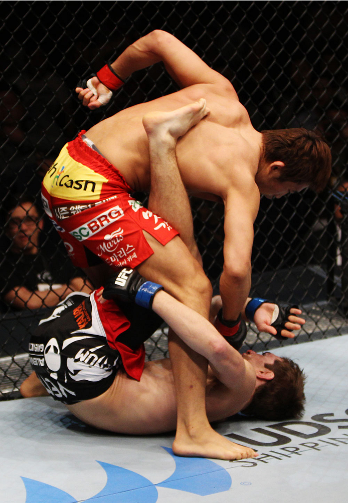 MACAU - MARCH 01:  Dong Hyun Kim unleashes punches on John Hathaway in their welterweight fight during the UFC Fight Night event at the Venetian Macau on March 1, 2014 in Macau. (Photo by Mitch Viquez/Zuffa LLC/Zuffa LLC via Getty Images)