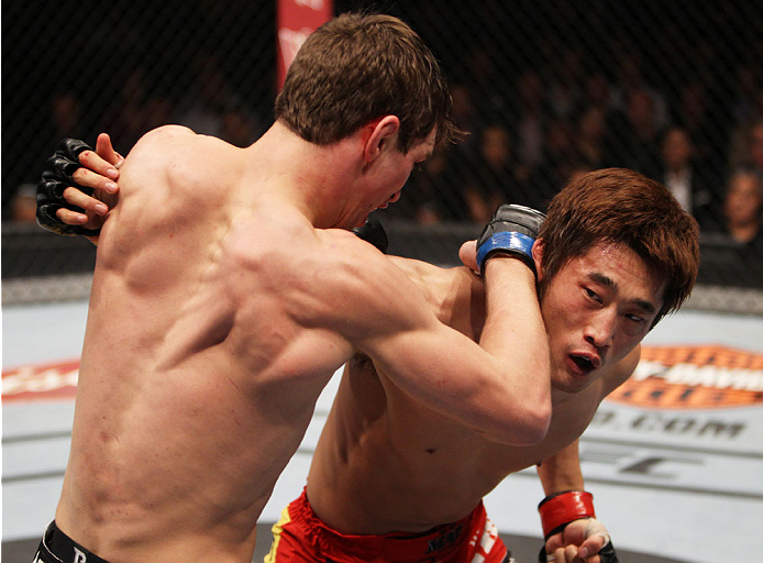 MACAU - MARCH 01:  (L to R) John Hathaway and Dong Hyun Kim exchange punches in their welterweight fight during the UFC Fight Night event at the Venetian Macau on March 1, 2014 in Macau. (Photo by Mitch Viquez/Zuffa LLC/Zuffa LLC via Getty Images)