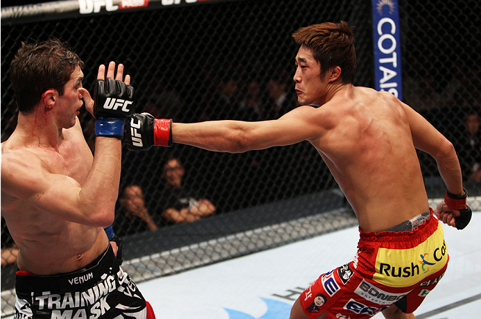 MACAU - MARCH 01:  Dong Hyun Kim throws a punch at John Hathaway in their welterweight fight during the UFC Fight Night event at the Venetian Macau on March 1, 2014 in Macau. (Photo by Mitch Viquez/Zuffa LLC/Zuffa LLC via Getty Images)