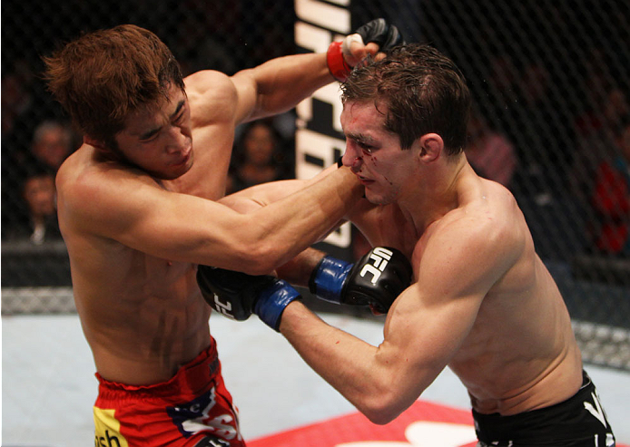 MACAU - MARCH 01:  (L to R) Dong Hyun Kim and John Hathaway exchange punches in their welterweight fight during the UFC Fight Night event at the Venetian Macau on March 1, 2014 in Macau. (Photo by Mitch Viquez/Zuffa LLC/Zuffa LLC via Getty Images)