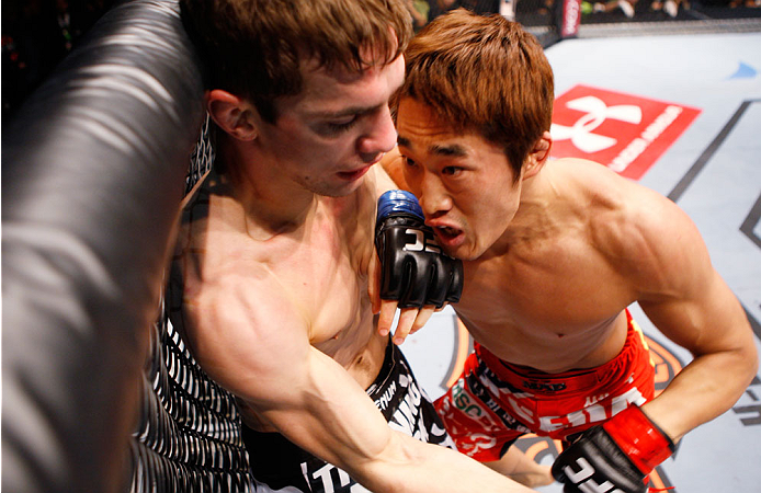MACAU - MARCH 01:  Dong Hyun Kim pushes John Hathaway against the cage in their welterweight fight during the UFC Fight Night event at the Venetian Macau on March 1, 2014 in Macau. (Photo by Mitch Viquez/Zuffa LLC/Zuffa LLC via Getty Images)