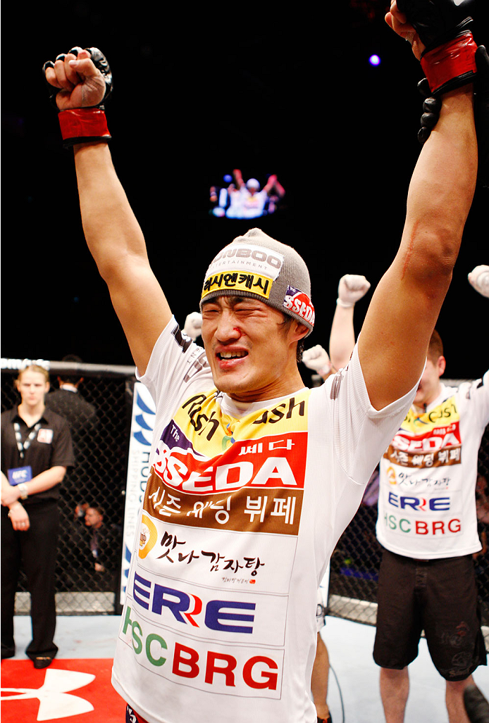 MACAU - MARCH 01:  Dong Hyun Kim celebrates after win over John Hathaway in their welterweight fight during the UFC Fight Night event at the Venetian Macau on March 1, 2014 in Macau. (Photo by Mitch Viquez/Zuffa LLC/Zuffa LLC via Getty Images)