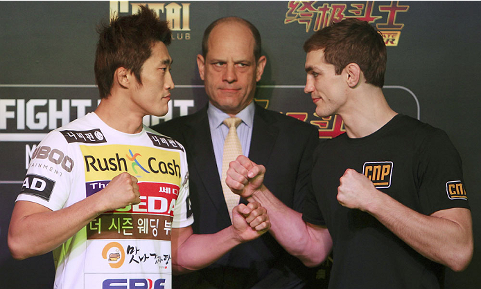 MACAU - FEBRUARY 27:  (L-R) Dong Hyun Kim and John Hathaway face off after an open training session for media at the Venetian Macao on February 27, 2014 in Macau. (Photo by Mitch Viquez/Zuffa LLC/Zuffa LLC via Getty Images)