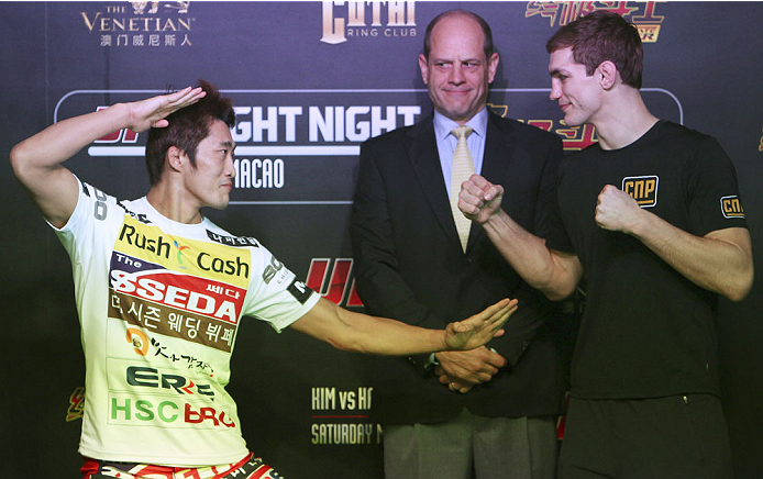 MACAU - FEBRUARY 27:  (L-R) Dong Hyun Kim and John Hathaway face off during the UFC open workouts at the Venetian Macao on February 27, 2014 in Macau. (Photo by Mitch Viquez/Zuffa LLC/Zuffa LLC via Getty Images)