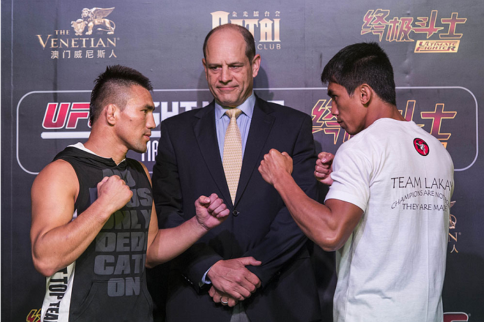 MACAU - FEBRUARY 27:  (L-R) Jumabieke Tuerxun and Mark Eddiva face off during the training session for the media at Venetian Macau on February 27, 2014 in Macau, Macau.  (Photo by Xaume Olleros/Zuffa LLC)
