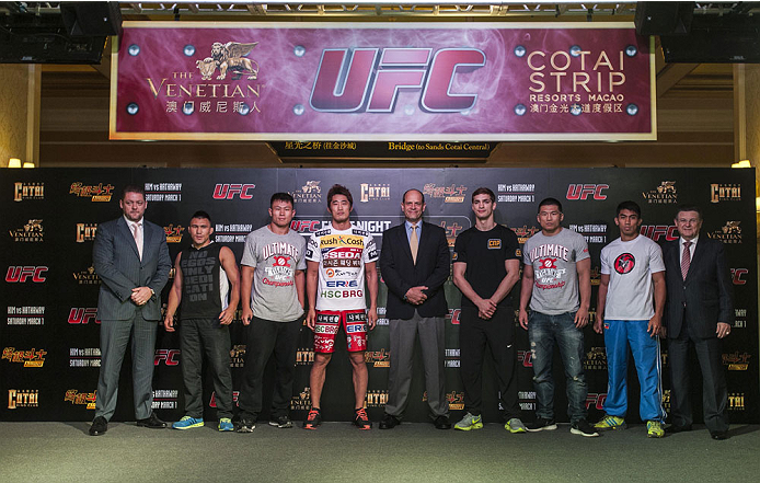 MACAU - FEBRUARY 27:  (L-R) Jumbieke Tuerxun, Zhang Lipeng, Dong Hyun Kim, UFC Asia Managing Director Mark Fischer, John Hathaway, Wang Sai and Mark Eddiva pose for media at Venetian Macau on February 27, 2014 in Macau, Macau. (Photo by Xaume Olleros/Zuffa LLC)