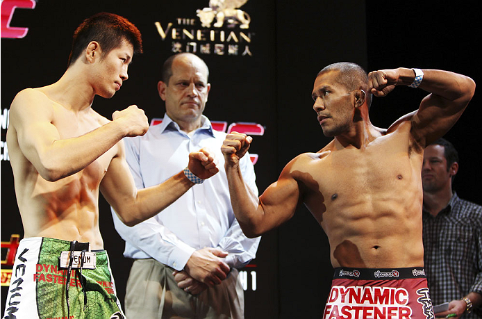 MACAU - FEBRUARY 28:  (L and R) Hatsu Hioki and Ivan Menjivar face off during the UFC weigh-in event at the Venetian Macau on February 28, 2014 in Macau. (Photo by Mitch Viquez/Zuffa LLC/Zuffa LLC via Getty Images)