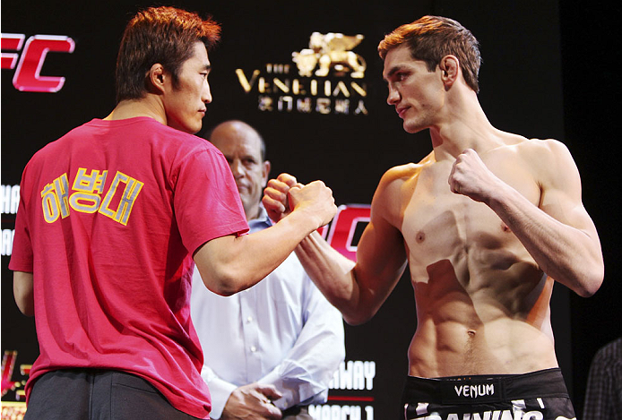 MACAU - FEBRUARY 28: (L and R) Dong Hyun Kim and John Hathaway face off during the UFC weigh-in event at the Venetian Macau on February 28, 2014 in Macau. (Photo by Mitch Viquez/Zuffa LLC/Zuffa LLC via Getty Images)