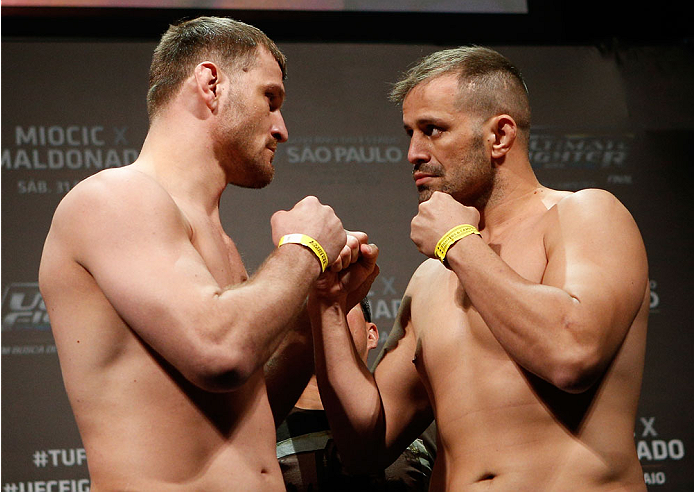 SAO PAULO, BRAZIL - MAY 30:  (L-R) Opponents Stipe Miocic and Fabio Maldonado face off during the UFC Fight Night weigh-in at the Ginasio do Ibirapuera on May 30, 2014 in Sao Paulo, Brazil.  (Photo by Josh Hedges/Zuffa LLC/Zuffa LLC via Getty Images)
