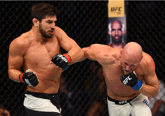 SASKATOON, SK - AUGUST 23:  (L-R) Patrick Cote punches Josh Burkman of the United States in their welterweight bout during the UFC event at the SaskTel Centre on August 23, 2015 in Saskatoon, Saskatchewan, Canada. (Photo by Jeff Bottari/Zuffa LLC/Zuffa LLC via Getty Images)