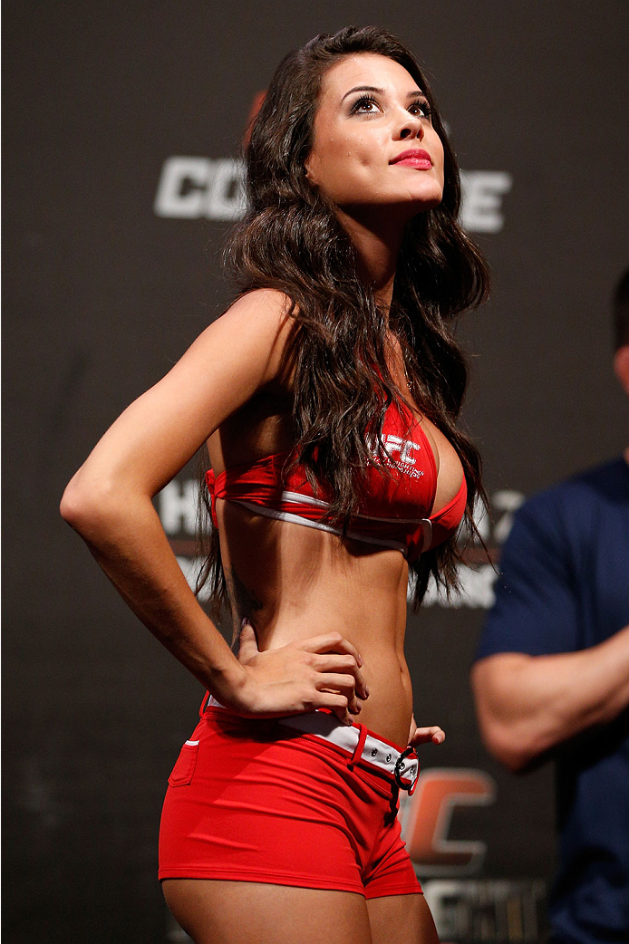 NATAL, BRAZIL - MARCH 22:  UFC Octagon Girl Camila Rodrigues de Oliveira stands on stage during the UFC weigh-in at Ginasio Nelio Dias on March 22, 2014 in Natal, Brazil. (Photo by Josh Hedges/Zuffa LLC/Zuffa LLC via Getty Images)