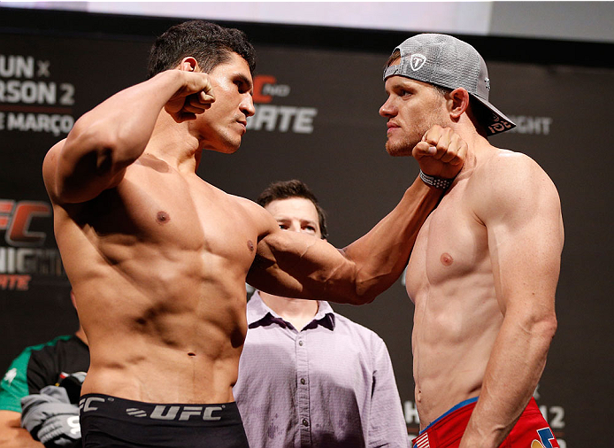 "NATAL, BRAZIL - MARCH 22:  (L-R) Opponents Cezar ""Mutante"" Ferreira and CB Dollaway face off during the UFC weigh-in at Ginasio Nelio Dias on March 22, 2014 in Natal, Brazil. (Photo by Josh Hedges/Zuffa LLC/Zuffa LLC via Getty Images)"