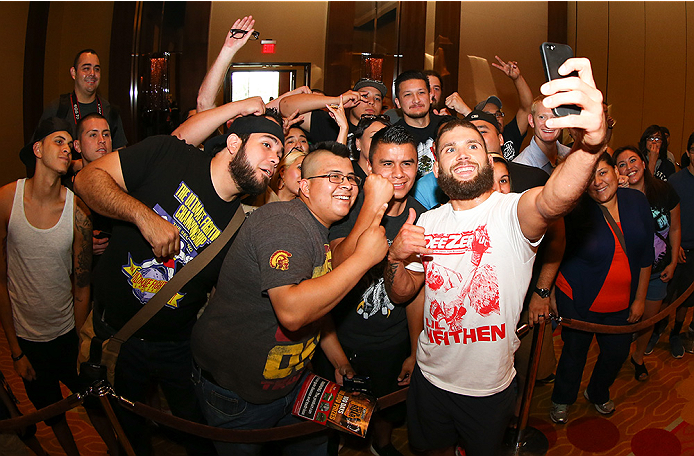 SAN ANTONIO, TX - JUNE 26:  Jeremy Stephens takes a selfie with fans after his open training session at the Grand Hyatt San Antonio on June 26, 2014 in San Antonio, Texas. (Photo by Ed Mulholland/Zuffa LLC/Zuffa LLC via Getty Images)