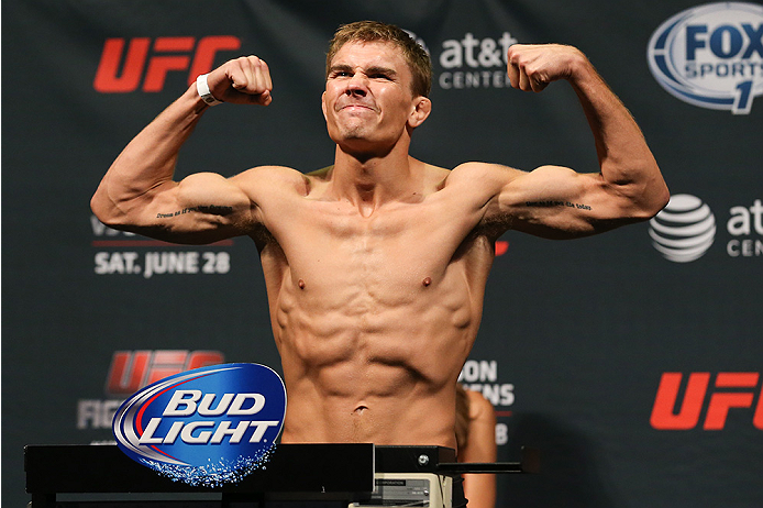 SAN ANTONIO, TX - JUNE 27: Cody Gibson steps on the scale during the UFC Fight Night weigh-in at the AT&T Center on June 27, 2014 in San Antonio, Texas. (Photo by Ed Mulholland/Zuffa LLC/Zuffa LLC via Getty Images)