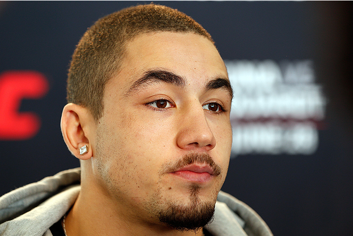AUCKLAND, NEW ZEALAND - JUNE 26:  Robert Whittaker interacts with media during the UFC Ultimate Media Day at The Cloud at Queen's Wharf on June 26, 2014 in Auckland, New Zealand.  (Photo by Josh Hedges/Zuffa LLC/Zuffa LLC via Getty Images)