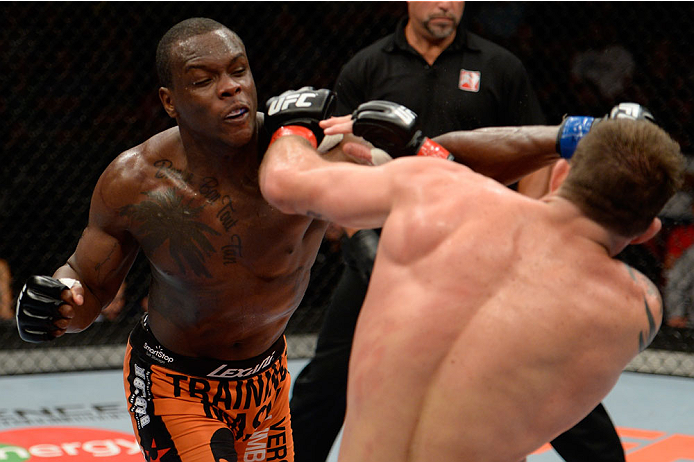 Ovince Saint Preux punches Ryan Bader in their light heavyweight bout during the UFC fight night event at the Cross Insurance Center on August 16, 2014 in Bangor, ME. (Photo by Jeff Bottari/Zuffa LLC)