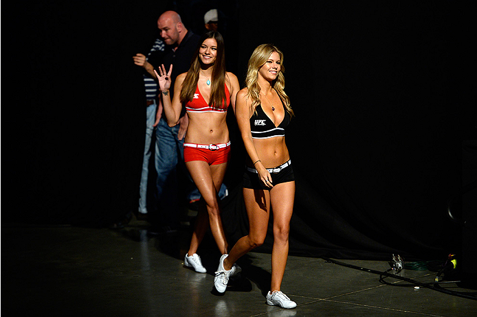 BANGOR, ME - AUG 15:  (R-L) UFC Octagon Girls Chrissy Blair and Vanessa Hanson walk to the stage during the UFC fight night weigh-in at the Cross Insurance Center on August 15, 2014 in Bangor, Maine. (Photo by Jeff Bottari/Zuffa LLC/Zuffa LLC via Getty Images)