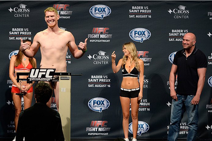 BANGOR, ME - AUG 15:  (L-R) Sam Alvey steps on the scale as UFC President Dana White reacts during the UFC fight night weigh-in at the Cross Insurance Center on August 15, 2014 in Bangor, Maine. (Photo by Jeff Bottari/Zuffa LLC/Zuffa LLC via Getty Images)