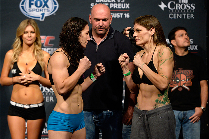 BANGOR, ME - AUG 15:  (L-R) Sara McMann and Lauren Murphy face off during the UFC fight night weigh-in at the Cross Insurance Center on August 15, 2014 in Bangor, Maine. (Photo by Jeff Bottari/Zuffa LLC/Zuffa LLC via Getty Images)