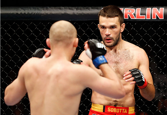 (L-R) Pawel Pawlak fights Peter Sobotta during the Pawel Pawlak vs. Peter Sobotta preliminary match of the UFC Fight Night event at O2 World on May 31, 2014 in Berlin, Germany. (Photo by Boris Streubel/Zuffa LLC)