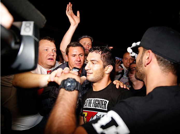 BERLIN, GERMANY - MAY 31:  Gegard Mousasi (C) poses with fans after winning the Gegard Mousasi vs. Mark Munoz match at UFC Fight Night Berlin event at O2 World on May 31, 2014 in Berlin, Germany. (Photo by Boris Streubel/Zuffa LLC/Zuffa LLC via Getty Images)