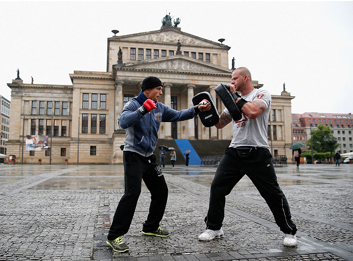 BERLIN, GERMANY - MAY 28:  Nick Hein (L) holds a Guerillia open air training session for fans and media at Gendarmenmarkt on May 28, 2014 in Berlin, Germany.  (Photo by Boris Streubel/Zuffa LLC/Zuffa LLC via Getty Images)
